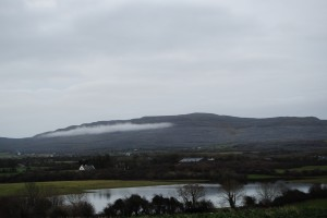 Here you can see one of the Burren's many rock-clad hills. A turlough (turlach), or temporary lake, lies in the foreground. Click to enlarge.